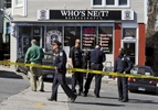Police on the scene of a shooting on Hamilton Street at the Who's Next Barbershop on Friday, April 15, 2016.