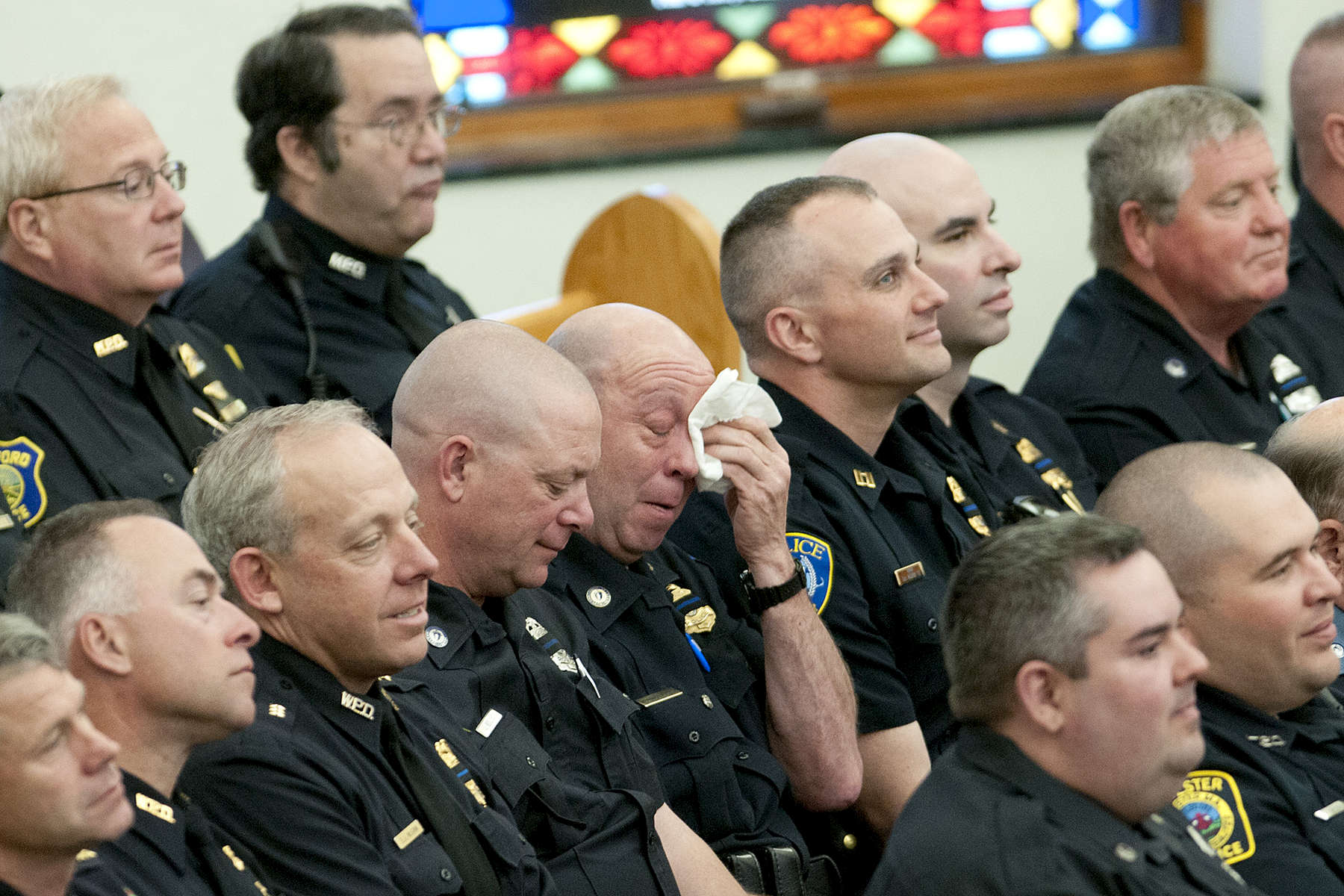 Police officers attend the funeral service for Auburn Police Officer Ronald Tarentino, Jr., 42, of Leicester, Mass. in St. Joseph's Church in Charlton on Friday, May 27, 2016. Officer Tarentino died after being shot during a traffic stop Sunday.