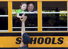 Rahim Nuhaj gives his daughter, Hanna, 4, a high five as she explores a school bus with her mom, Ashley, during the Countdown to Kindergarten event at the EcoTarium on Tuesday, August 23, 2016.