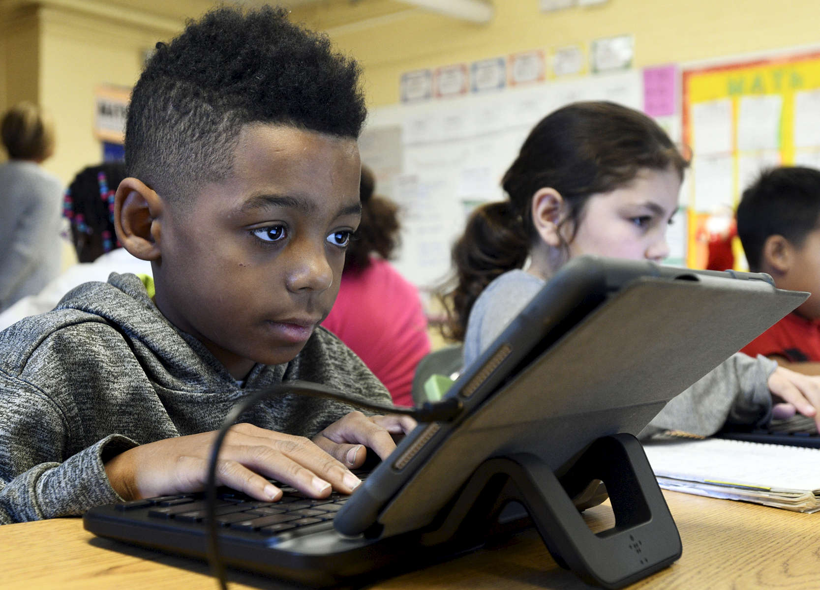 Union Hill School fourth-grader Trent LeShore, 9, works on his iPad on Friday, December 9, 2016. Worcester school committee members are contemplating taking action to reduce affects of wifi radiation on students and staff.