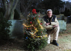 Charles Iliffe, 54, and his friends decorated a Christmas tree at the gravesite of Iliffe's brother, William, and mother, Peggy, at Beechwood Cemetery. The tradition of setting up the tree was started by Peggy and Charles after William's death in 1973. After a lapse due to Peggy's passing, Charles has renewed the tradition on Thursday, December 5, 2014.