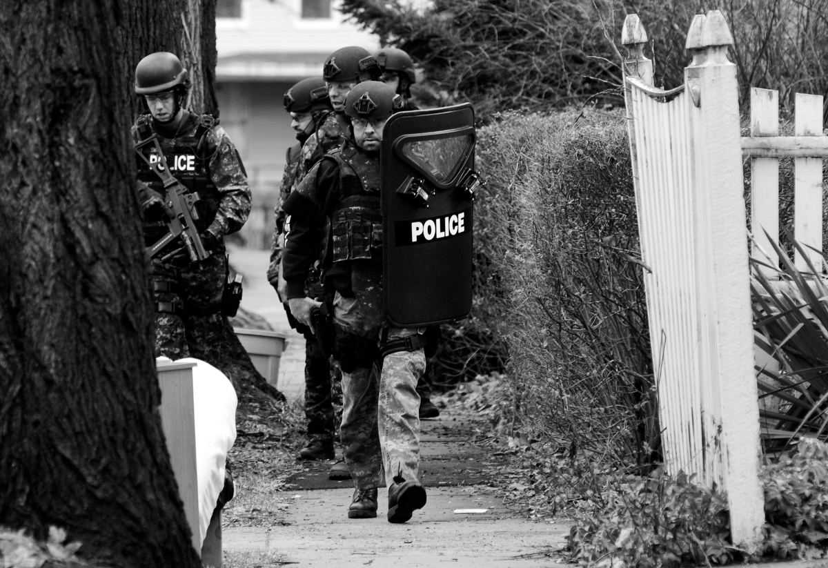 SWAT team members arrive on the scene at 25 Cargill Ave on Wednesday, Dec. 17, 2014.