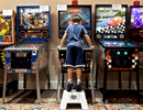 Daniel Davis, 6, of Boston doesn't let his smaller stature keep him from the tables during the Pintastic Pinball Game Room Expo at the Sturbridge Host Hotel on Saturday, July 9, 2016.
