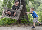 Charlie Kraman, 4, pushes his sister, Fiala, 7, in a swing at Tower Hill Botanical Garden on Thursday, August 25, 2016.