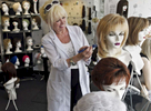 Sonja Zonia, who has owned the Sonja's Wig Salon for 20 years, styles wigs in her display window on Wednesday, August 31, 2016. She said she receives a business from many different clients including cancer patients and people who have alopecia.