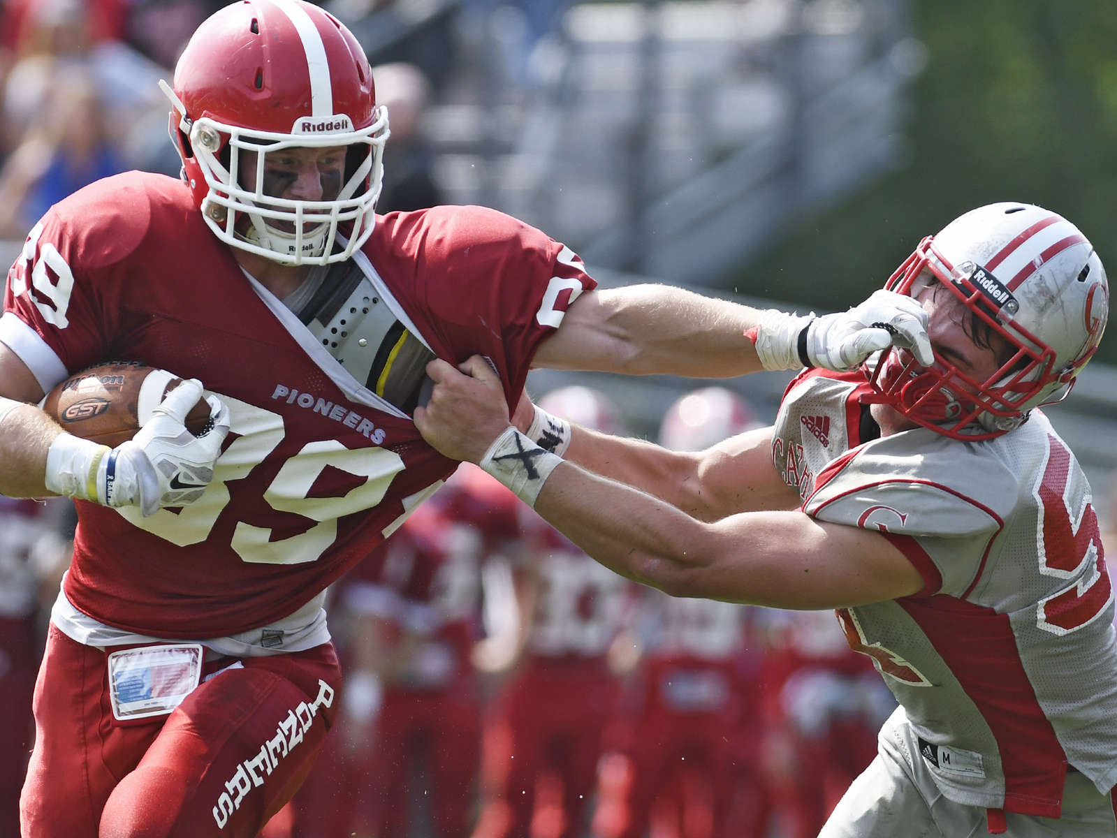 St. John's defensive end Tom Feraco stiff arms Catholic Memorial defensive lineman Matthew Rowan on Saturday, September 10, 2016.