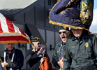 Members of the Worcester Chapter of the Jewish Veterans of the United States react as their flag blows into Morty Grossman's face during the Veterans Day parade on Friday, November 11, 2016.