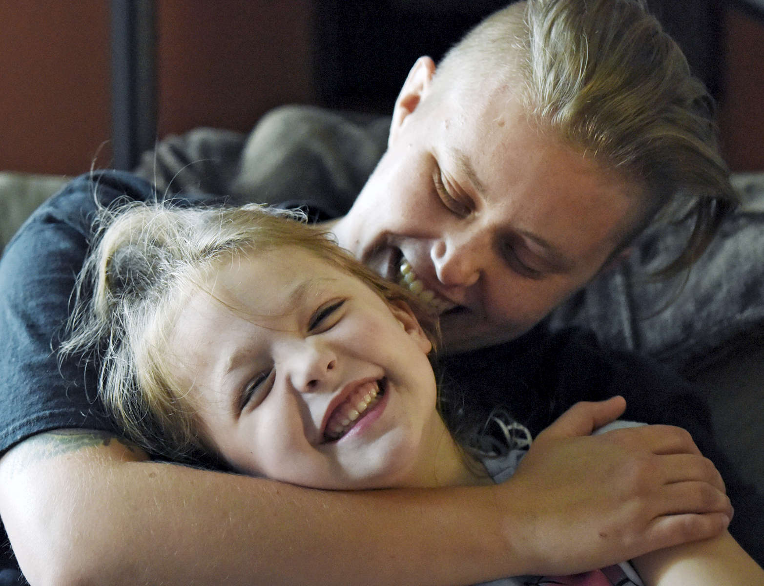 EJ Silverberg spends time with his daughter Brooke Depari, 5, in his North Grafton home on Thursday, June 16, 2016. Silverberg is transgender and plans to have chest reconstruction surgery.