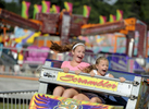 Neighbors Kaitlyn Riley, 11, and Emma Itri, 7, both of Bourne scream as they ride the Scrambler at the Barnstable County Fair on opening day at Cape Cod Fairgrounds.