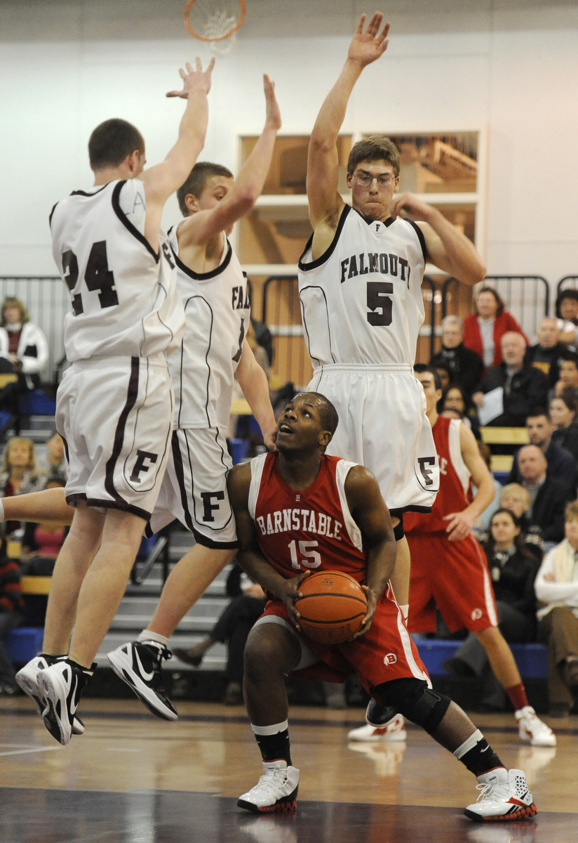Barnstable guard Jason Eddy (15) finds himself surrounded by Falmouth's Pat Kotfila (24), Nate Steele (14) and Kyle Kasprzyk (5). Barnstable beat Falmouth by one point in a nail-biting last period, 46-45.
