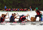 Samantha Kidd of Northbridge beats the drum on team Barton Associates, which ended up winning their heat on a technicality during the Dragon Boat Races on Quinsigamond Lake at Regatta Point in Worcester. © Christine Hochkeppel