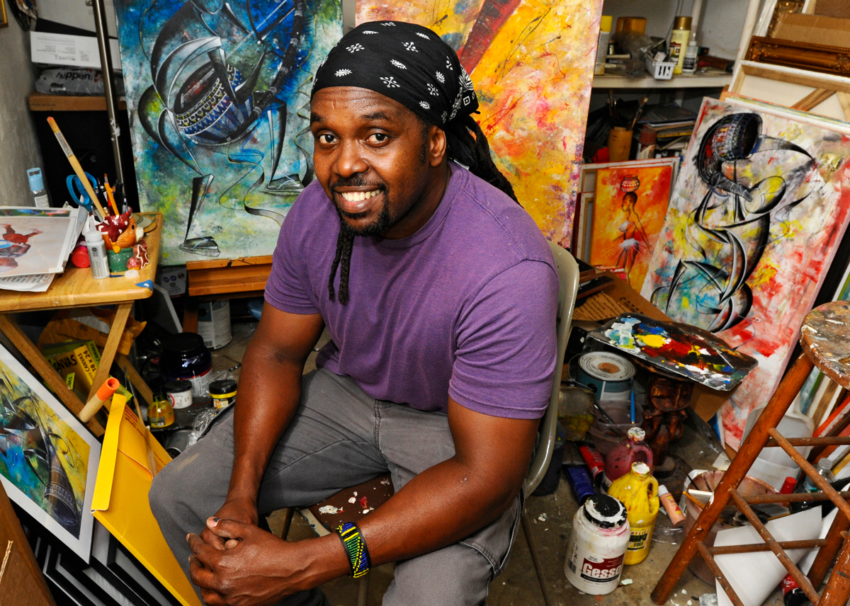 Abu Mwenye is his Worcester garage art studio on Thursday, September 17, 2015. Mwenye is an artist and home health care worker. © Christine Hochkeppel