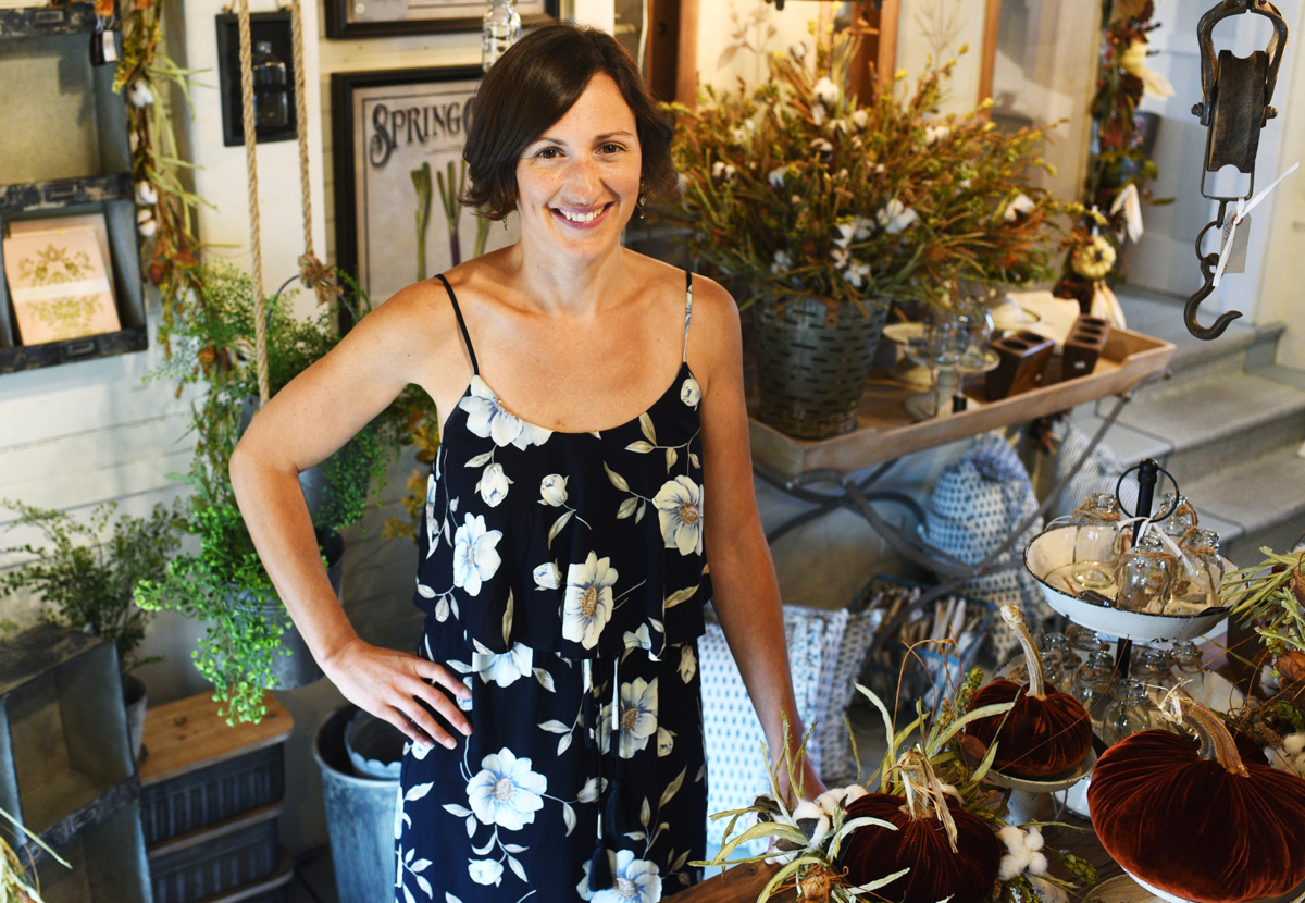 Kimberly Reed in her farmhouse-style home decor shop, Purple Rose Home, in Northborough. © Christine Hochkeppel