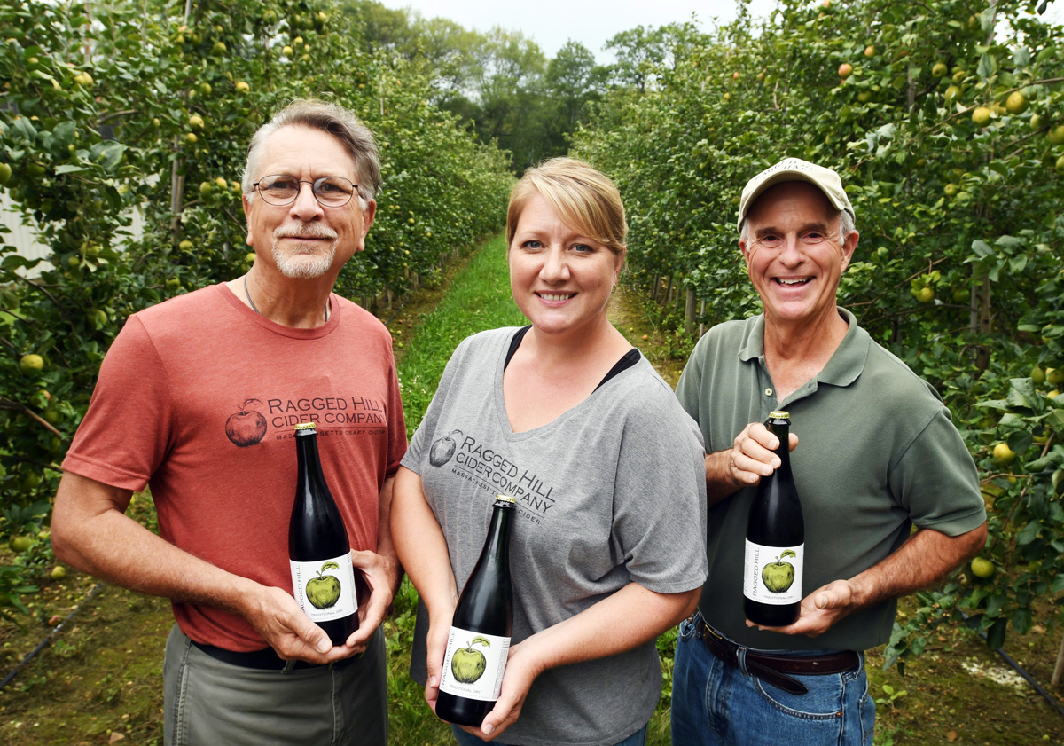 From left, Ragged Hill Cider Company owners Steve Garwood, Anne Garwood-Hampp and Keith Arsenault with their traditional dry craft hard cider in West Brookfield. © Christine Hochkeppel