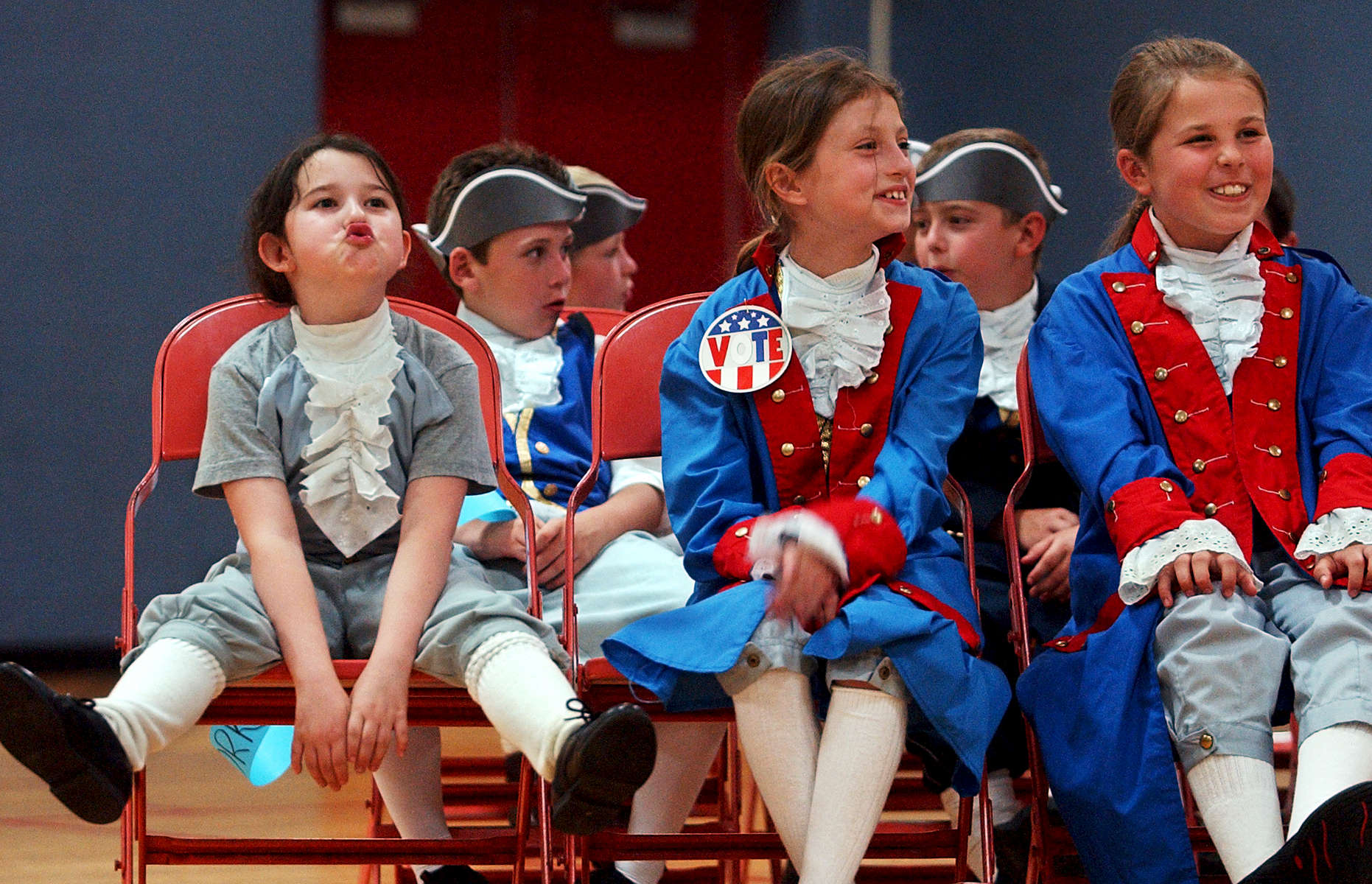Martin Elementary School third grader Rachel Tinley (left) oohs along to {quote}Where do I Sign?{quote} in her class' American Revolution musical performance on Tuesday, June 13, 2006.