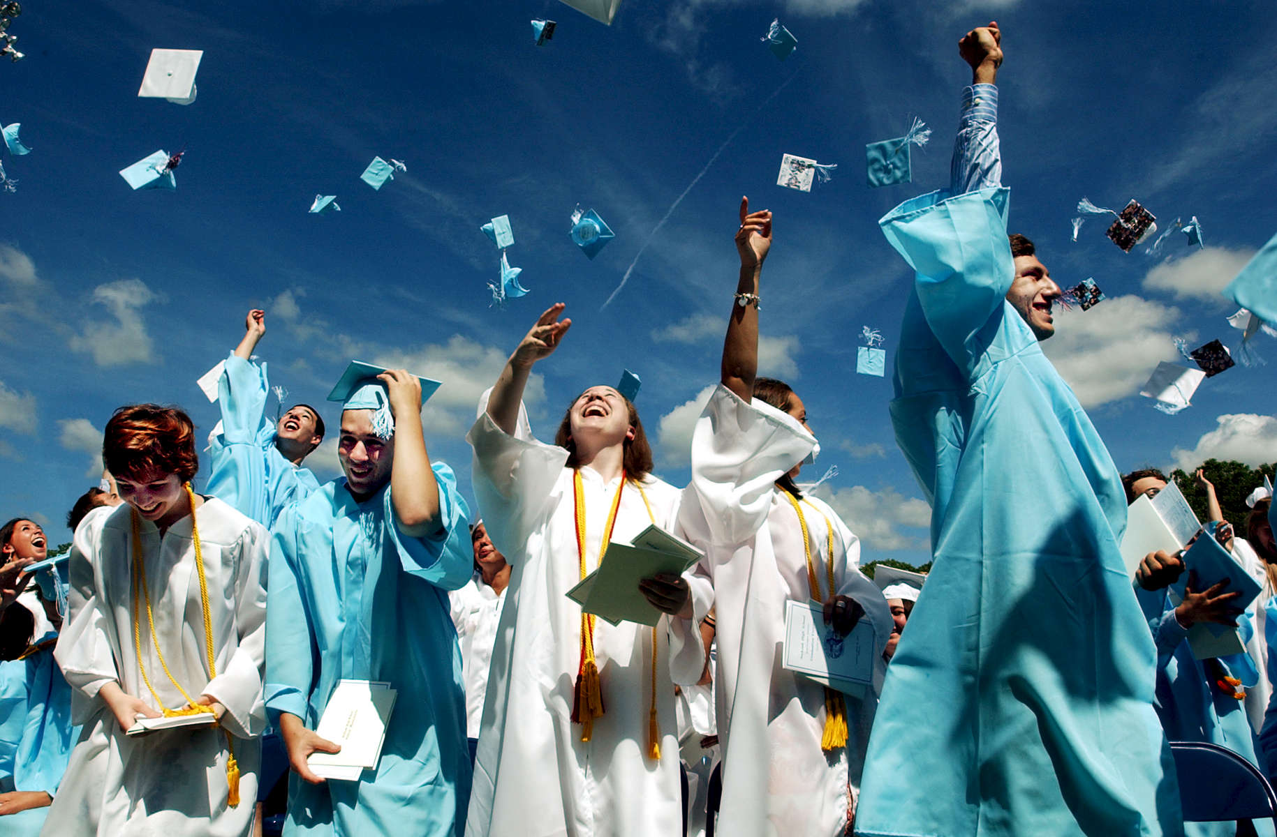 The Seekonk High School graduating class of 2007 tosses their caps into the sky at the closing of commencement on Sunday, June 18, 2007.