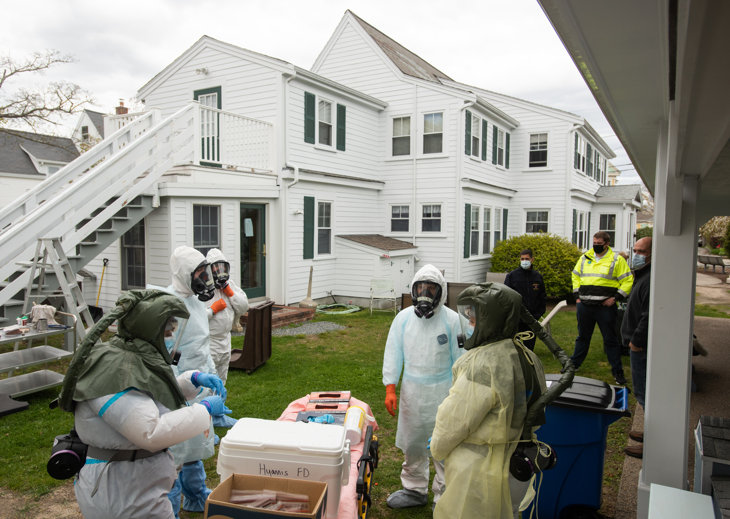 HYANNIS - Members of the Hyannis Fire Department, nurses from Cape Cod Healthcare and staff from Duffy Health Center set up a COVID-19 testing site at CHAMP Homes transitional housing for adults who have experienced homelessness on Tuesday, May 12, 2020.