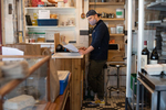 PROVINCETOWN - Rob Anderson co-owner of the Canteen, a popular beachside cafe, enters an order from an elderly customer who called in her grocery list, Tuesday, April 21, 2020. Anderson has received over $11,000 in donations to go toward free grocery orders for those who need assistance.