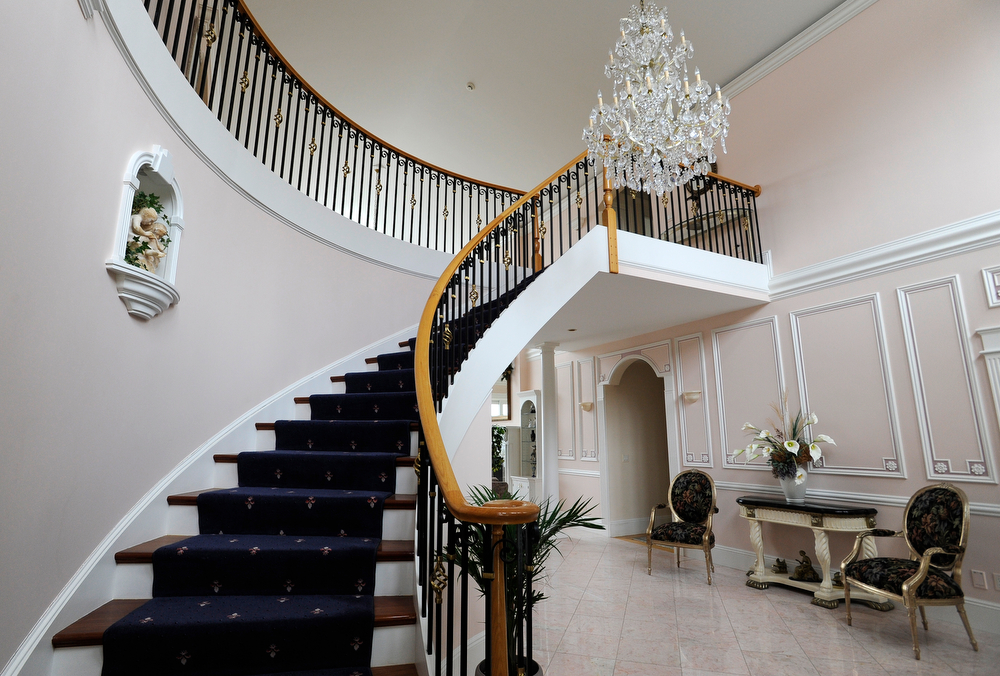 OSTERVILLE -- 051711 -- The grand staircase in the fourier of Carolyn and Andrew Lane's home on South Bay Road.  Cape Cod Times/Christine Hochkeppel 051711ch03
