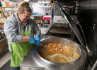 HYANNIS - Faith Family Kitchen chef Jeni Wheeler stirs a 35-gallon cauldron of beef stew on Thursday, April 2, 2020. She has been stewing 6 sides of beef tenderloin overnight.