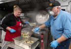 HYANNIS - Faith Family Kitchen chef Jeni Wheeler and volunteer Jack Joyce pull clams from the cauldron on Friday, April 3, 2020. A donation from Wellfleet SPAT, Shellfish Promotion and Tasting, Inc., featured Holbrook littlenecks over butter garlic pasta.