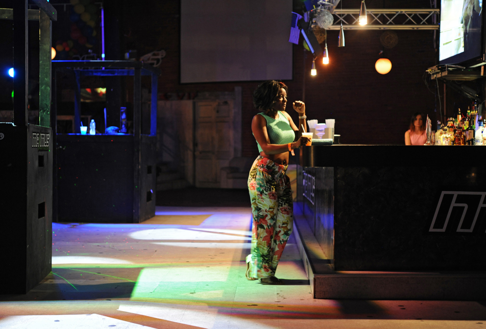 10:50 p.m. -- Cherilyn Ylieret, 30, of Fort Lauderdale, Fla. stands at the bar with her drink at Pufferbellies night club for Mix Up and Dashout Ragashanti with Wally British on Saturday, August 30, 2014.