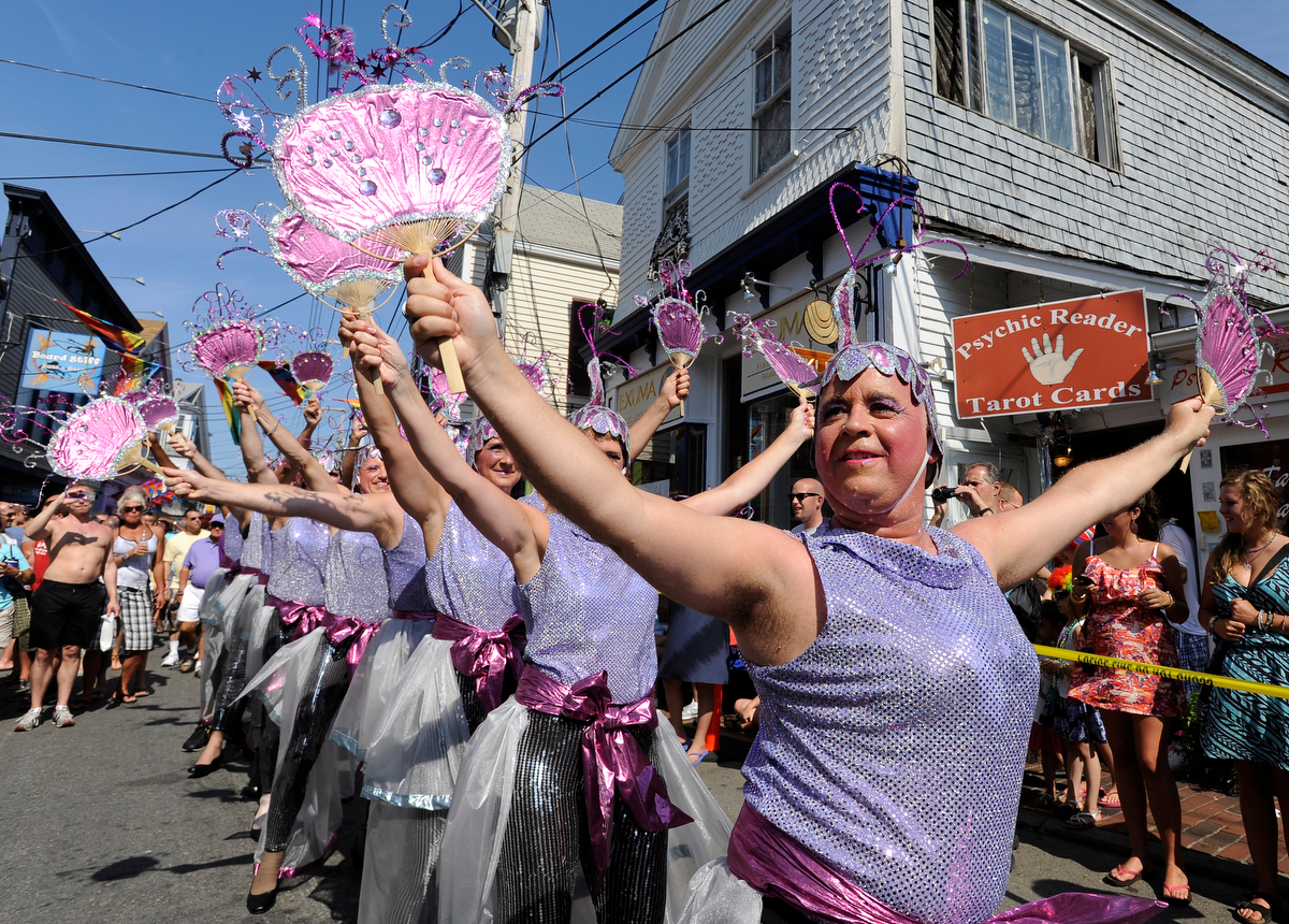 PROVINCETOWN -- 08/18/11-- Jim McHugh of Minneapolis leads the Buzbee Berkley Dance Troupe in their routine on Commercial Street preceding the annual Carnival parade.