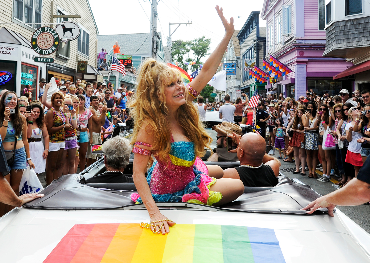 PROVINCETOWN -- 08/18/11-- Charo, the parade grand marshall, waves at her adoring fans during the Carnival celebration.