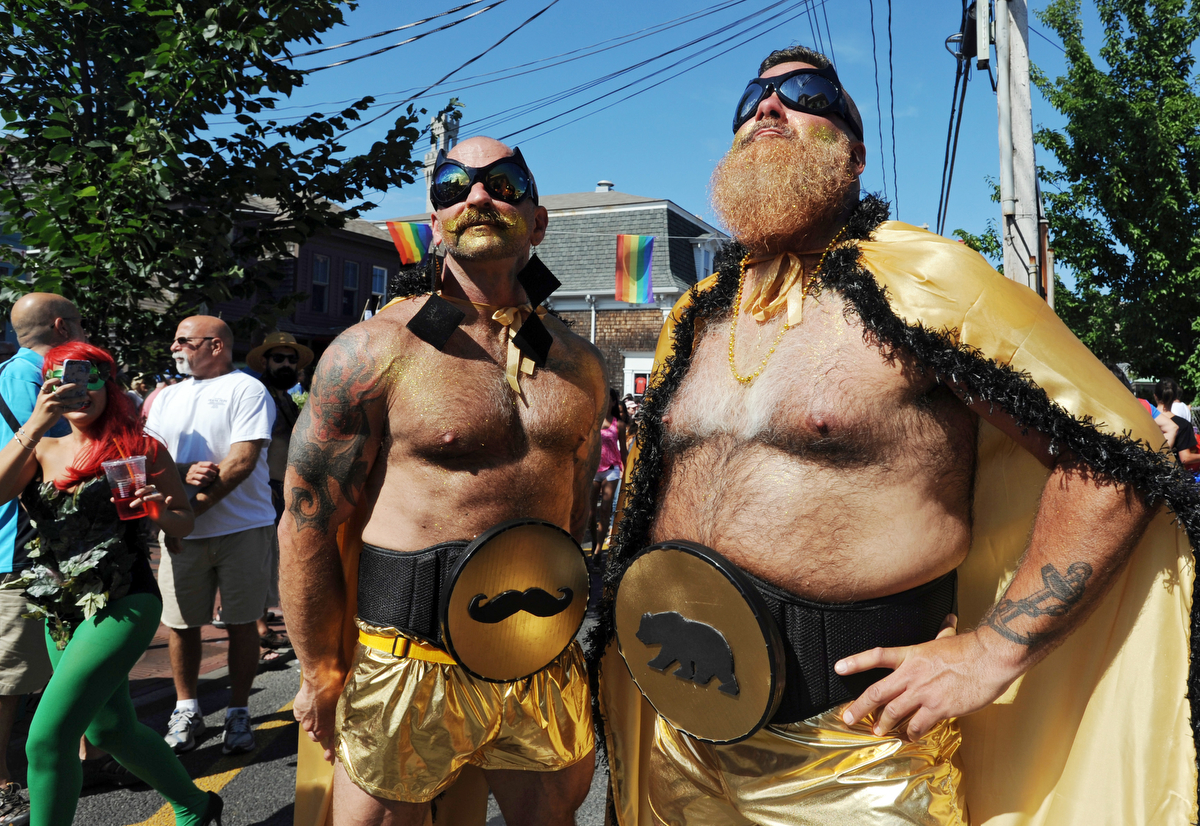 PROVINCETOWN -- 082114 -- Tony Ferringo and Ron Canal as Golden Stache and Golden Bear at the 36th Annual Carnival parade with the theme Comic Book Capers.