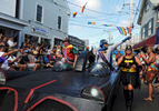 PROVINCETOWN -- 082114 -- Batman and Robin cruise down Commercial Street during the 36th Annual Carnival parade with the theme Comic Book Capers.