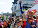PROVINCETOWN -- 082114 -- Louis Yungling of Brooklyn, N.Y., far right, cheers on a marching band during the 36th Annual Carnival parade with the theme Comic Book Capers.