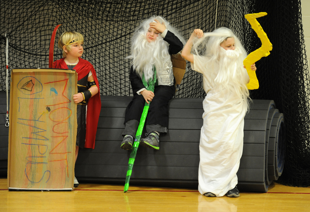 From left, Brendan Houle as Aries, Connor Brewster as Poseidon and Noah Hayden as Zeus, wait {quote}on deck{quote} before performing their movie trailer in the {quote}Coming Attractions{quote} challenge. The third-graders from Centerville Elementary School created a skit where they travel to ancient Greece and Egypt via time machine. Destination Imagination, a creative problem solving competition, involved 61 Cape and South Coast based teams and was held at Dennis-Yarmouth Regional High School. The winners will move on to the state level of the competition.