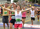 Emily Gesner of Marshfield appears relieved as she completes her first Falmouth Road Race.