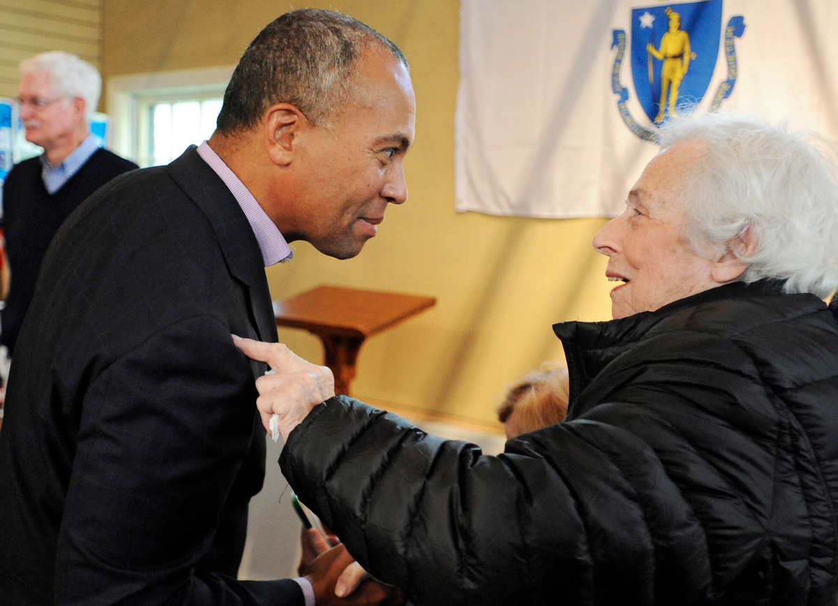 Gov. Deval Patrick shakes hands with Thelma Goldstein of Falmouth at the Sandwich Democratic Town Committee's coordinated campaign office. © Christine Hochkeppel