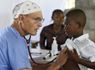 Dr. David Davis of Petersham listens to a young boy's heartbeat at the Adventist Church in Ducis, Haiti on Wednesday, November 2, 2016.