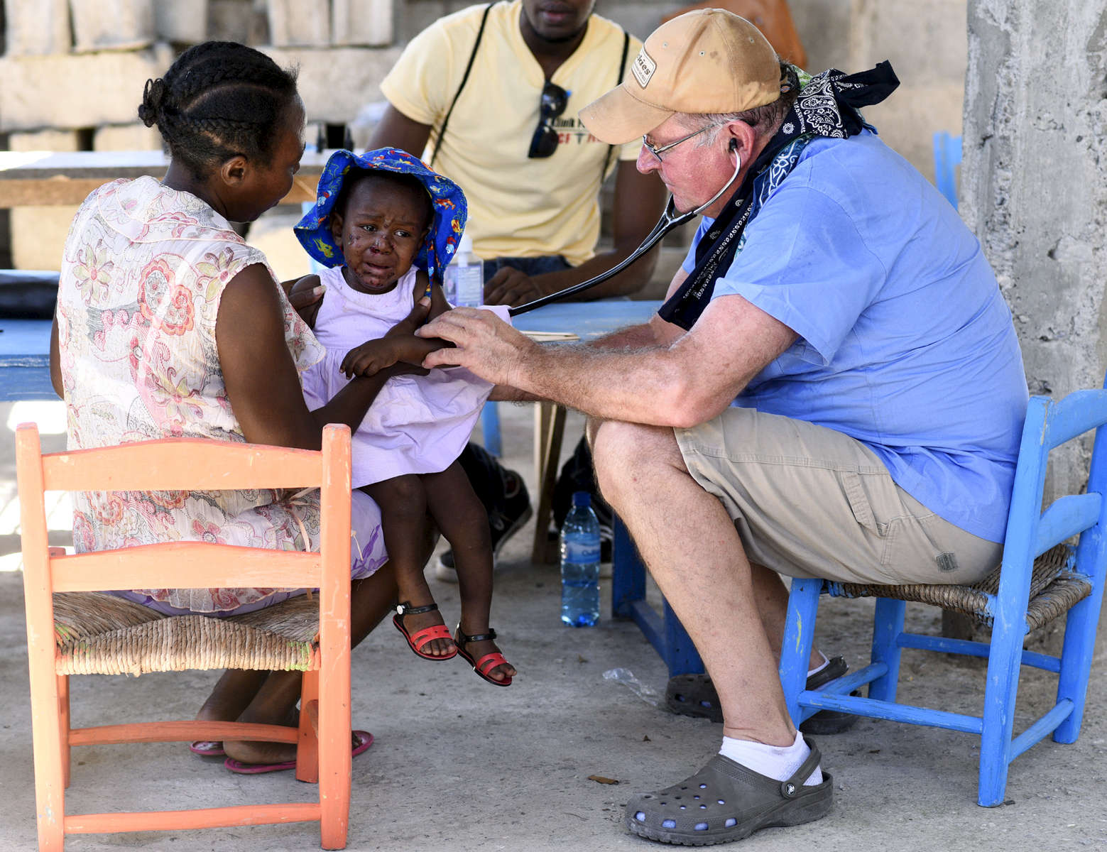 Dr. John Harrington of Gardner performs an exam on a young girl at the Adventist Church in Ducis, Haiti on Wednesday, November 2, 2016.