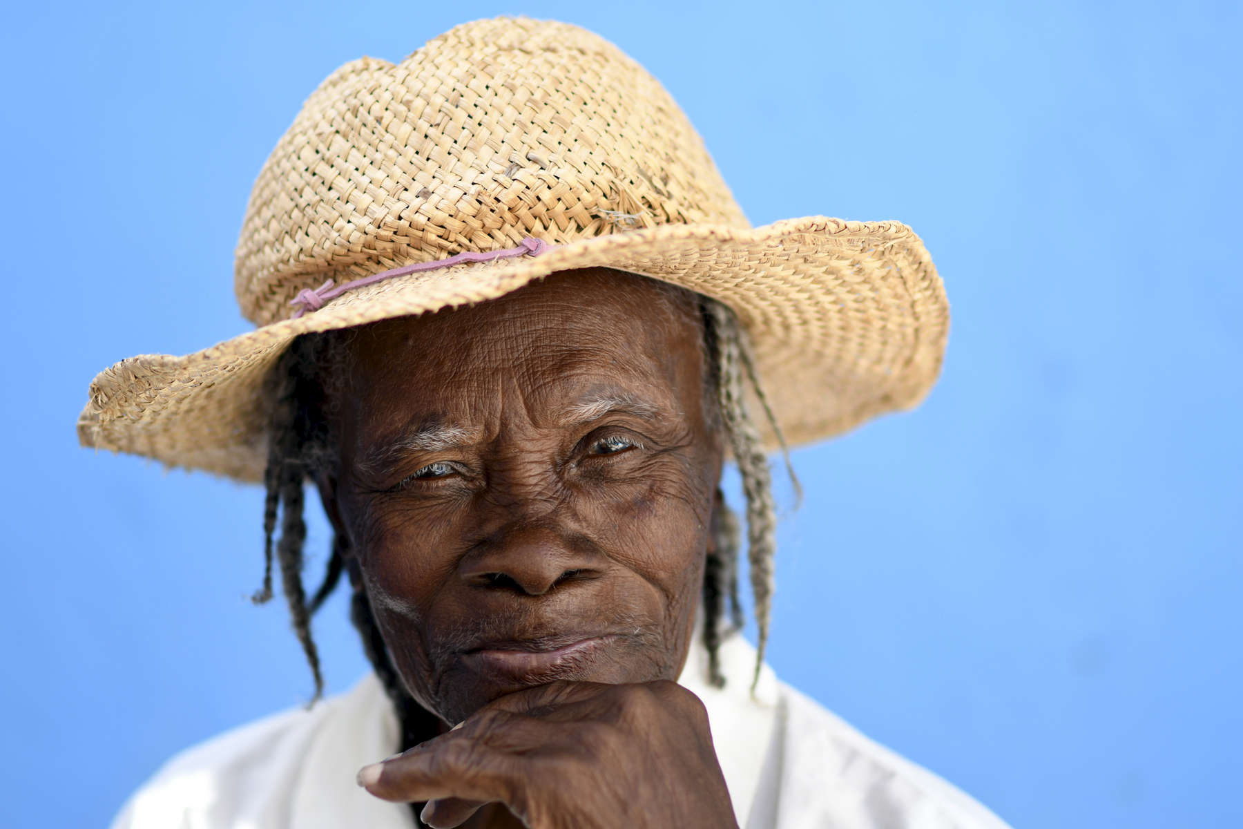 Maguilina Guerisson, 100, a former meat merchant born in Cuba, poses for a photo at a Forward in Health pop-up clinic at the Ecole Presbyteral de Dantan on Wednesday, November 2, 2016.