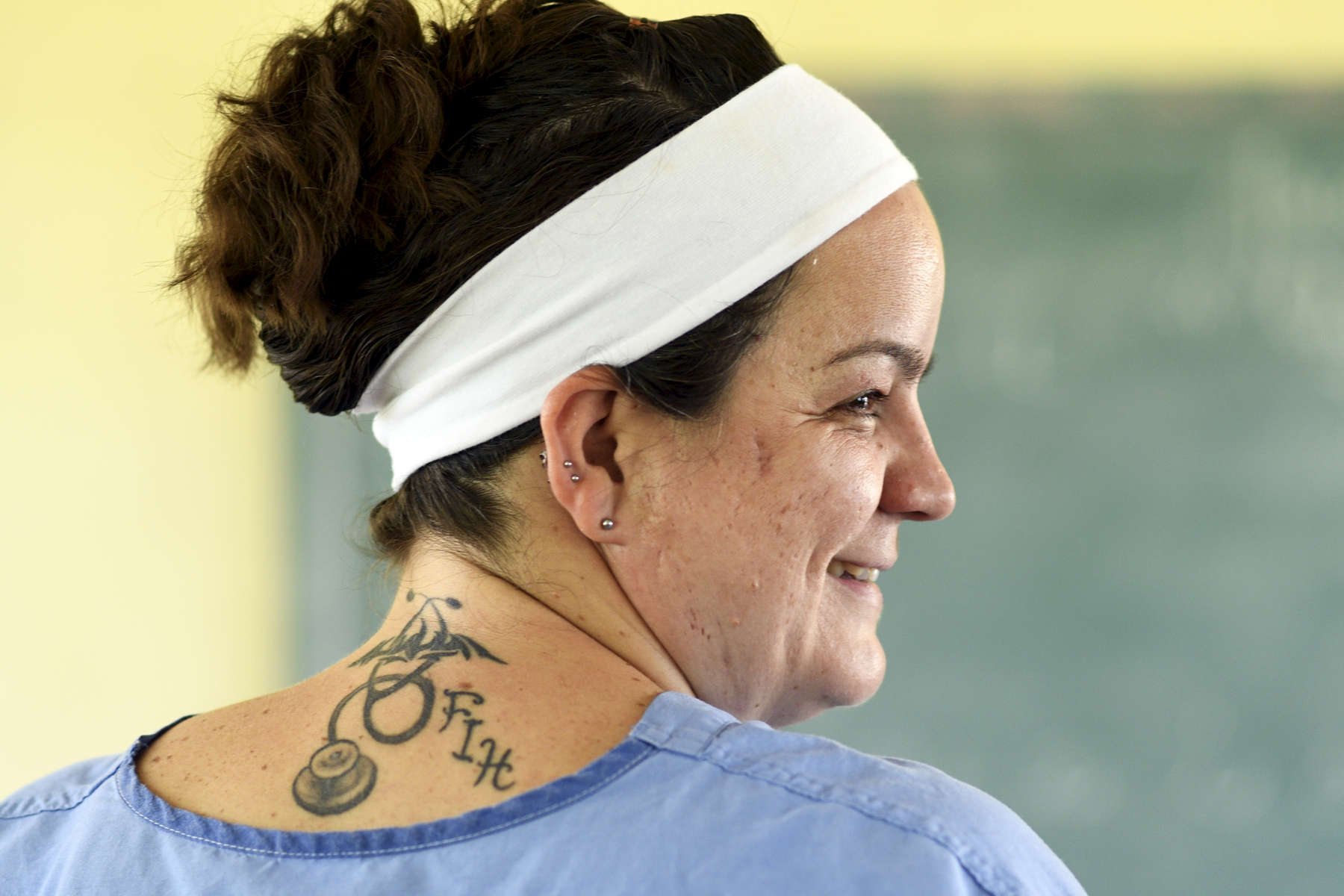RN Lori Belliveau of Fitchburg shows off her Forward in Health tattoo during a pop-up clinic at the Ecole Presbyteral de Dantan on Wednesday, November 2, 2016. She is on her third trip with FIH and is leading another one in February.