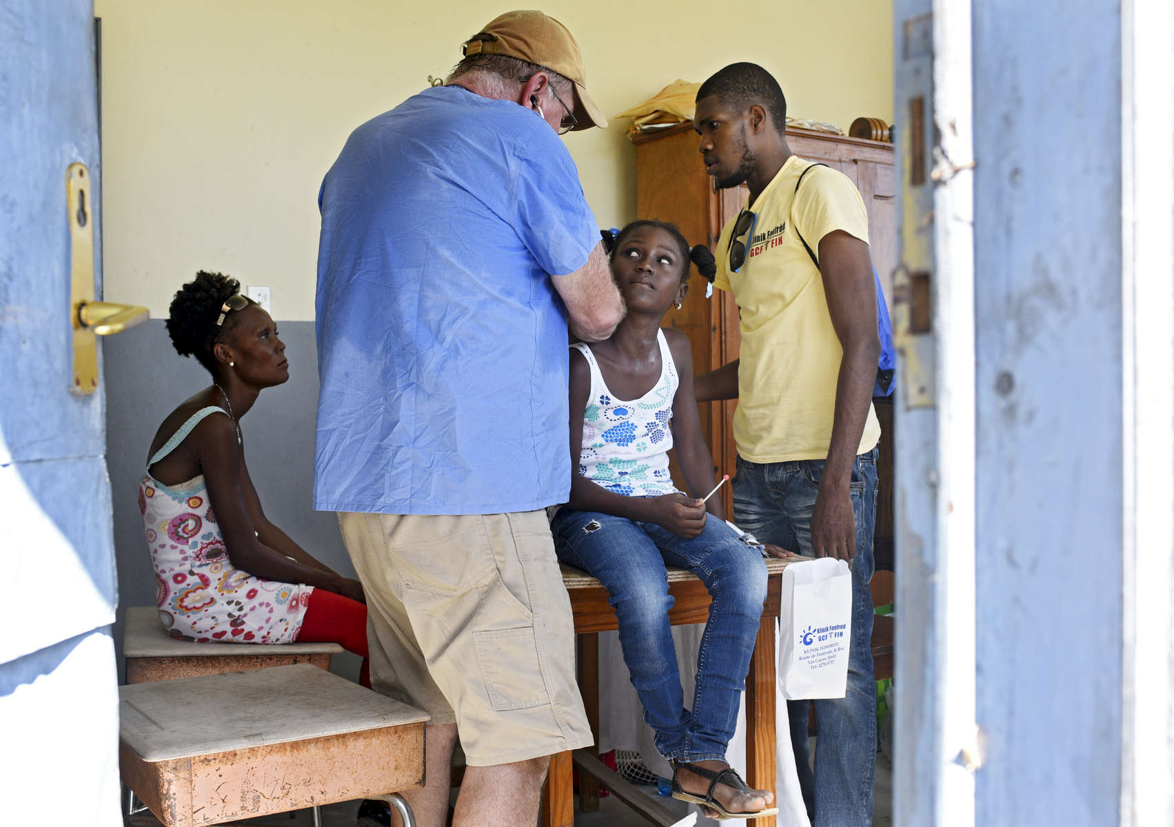 Dr. John Harrington listens to a young patients lungs during a Forward in Health pop-up clinic at the Ecole Presbyteral de Dantan on Wednesday, November 2, 2016.