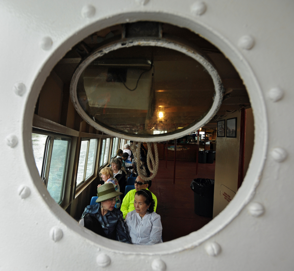 CAPE COD CANAL -- 060914 -- Passengers in the seating below the deck aboard Viking on a Canal Cruise.