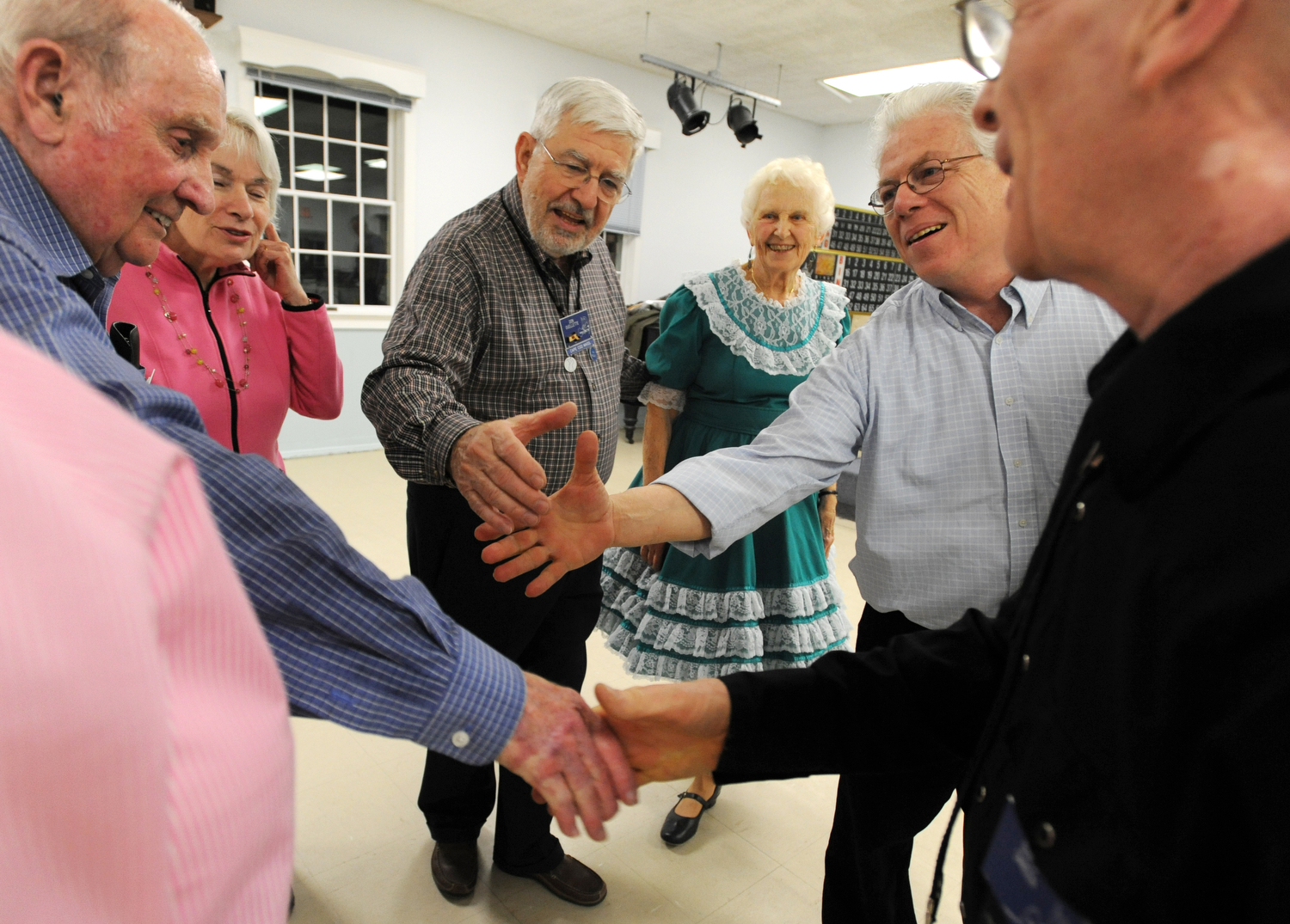 The last square of the night glad hands with each other when the last call is done. Square Dance etiquette is very important to the members. A dancer is not supposed to talk while in a square because it can be distracting for others and it also isn't courteous to leave a square once you have joined. It is also customary to thank everyone in the square after each tip, which is the sequence of calls that makes up a dance to one song.