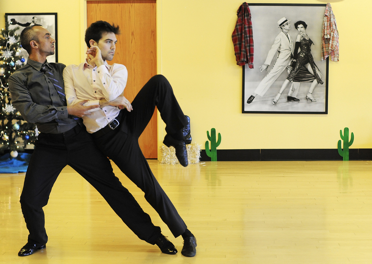 Professional dancers Kalin Mitov, left, and Michael Winward rehearse at the Fred Astaire Dance Studio. The gay dancing duo will be performing in a fundraiser they are organizing in Provincetown for the {quote}It Gets Better Project.{quote}