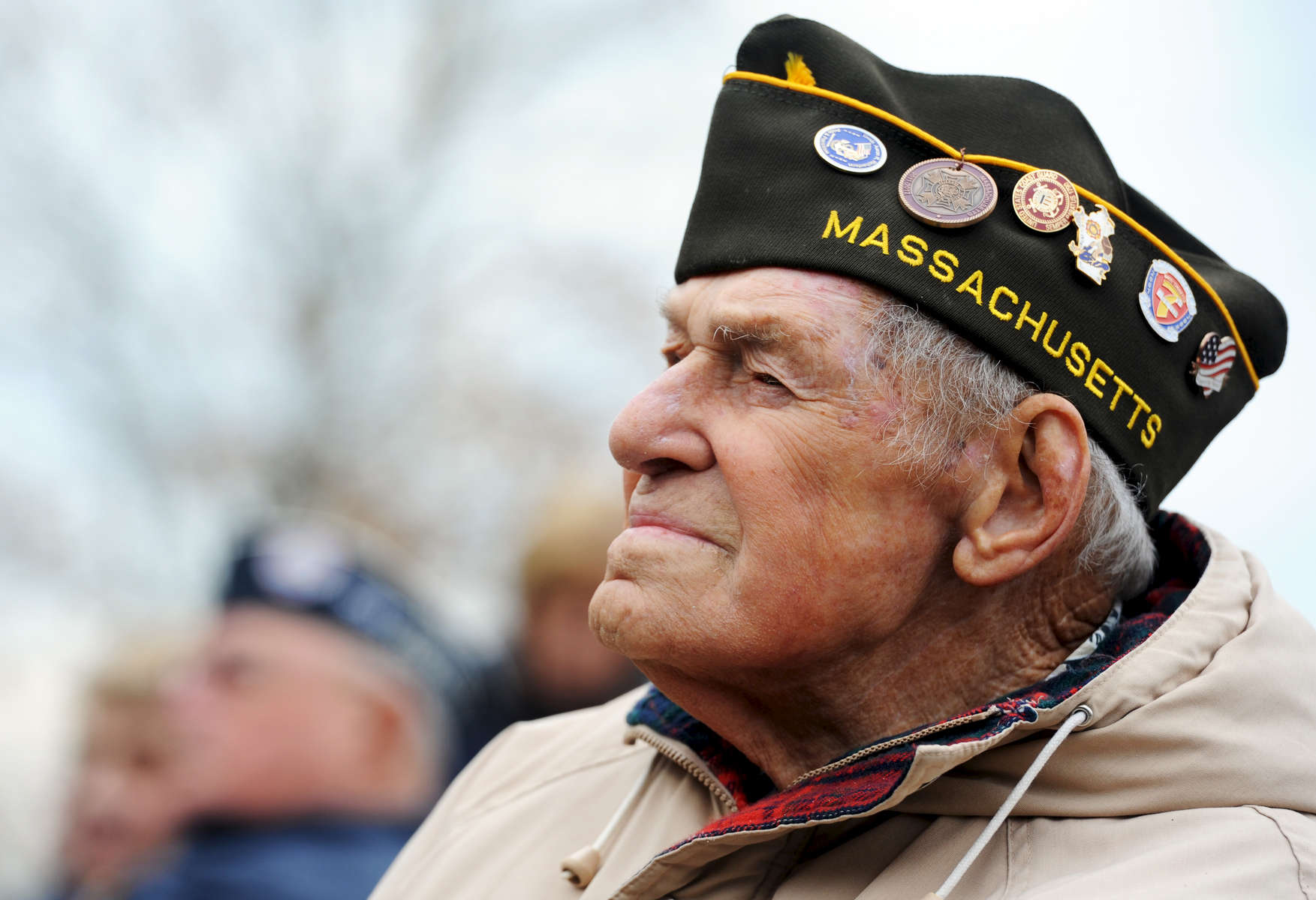 Ted duMoulin, 94, of Wareham, a retired U.S. Coast Guard machinist's mate, first class, attends the Veterans Day ceremony at Massachusetts National Cemetery.