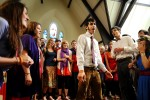 Emerson College sophomore Naveed Easton leads the a capella group that Matthew directed, Noteworthy, in an arrangement of The Beatles' song {quote}With a little help from my friends{quote} during the memorial service on Thursday, November 12, 2009.