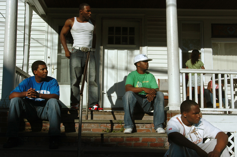 Maurice Cole (standing) hangs out with his friends on a break between trips helping a friend's aunt move from Pawtucket to Providence on Saturday, August 18, 2007.
