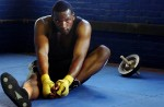 Maurice stretches during his workout at Manfredo's Gym on Thursday, May 3, 2007. {quote}Sometimes I get tired, or I had a bad day.{quote} Maurice Cole said of sticking to his strict schedule even though it can be easy to fall into a habit of making excuses.