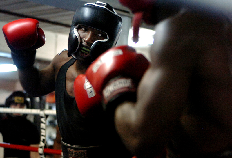 Maurice Cole spars with his friend and boxing peer, Vladine Biosse, at Manfredo's Gym on Thursday, May 3, 2007. {quote}Boxing is like a chess game...it's just, the war of the minds. You know they've got the same thing that you've got, in chess, they've got the same pieces. It's all about how you use your pieces. It's all about how we use our hands.{quote}