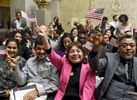 From left, Arthi Karthik of Westboro who immigrated from India, Karthik Subramanian of Westboro who immigrated from India, Rosa Gonzalez of Clinton who immigrated from Guatemala and Lord Odartei Brue of Worcester who immigrated from Ghana, wave their flags at the closing of the Naturalization Ceremony at the Worcester Art Museum on Wednesday, Jan. 11, 2017.