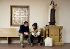 Richard Gonzalez of the Net of Compassion ministry, left, consoles Tracy O'Gillette, 50, who was just brought in to the St. John's Church shelter by the Quality of Life Task Force from the cold weather on Thursday, Dec. 15, 2016.