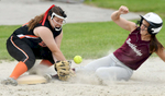 NORTHBRIDGE - Northbridge's Julia Fair slides into the bag as Uxbridge third baseman Samantha Dumais loses her grip on the ball, Tuesday, May 23, 2017.